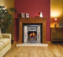 Chatsworth oak mantel with Victorian tiled front and Plant and Urn tile sets. Gazco coal effect fire